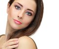 Beauty makeup female face looking closeup isolated portrait on white background Stock Photography