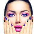 Beauty makeup purple make up and colorful bright nails Stock Photography