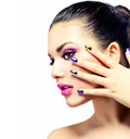 Beauty makeup purple make up and colorful bright nails Stock Image