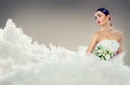 Beauty model bride in wedding dress with long train