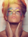 Beauty model with extreme make upe in havy colors Stock Image