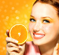 Beauty model girl with juicy oranges freckles Royalty Free Stock Images