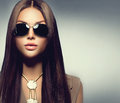 Beauty model girl wearing sunglasses with long brown hair Royalty Free Stock Photos