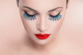 Beauty model woman with red sexy lips and blue false eyelashes Royalty Free Stock Photo
