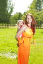 Beauty Mom And Baby Outdoors. ...