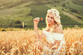 Beauty in nature beautiful young woman sitting wheat and enjoy Royalty Free Stock Photo