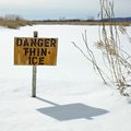 Beauty in nature warning sign of thin ice at lakeside orangeville dufferin county ontario canada Stock Photos