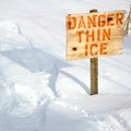 Beauty in nature warning sign of thin ice at lakeside orangeville dufferin county ontario canada Royalty Free Stock Images