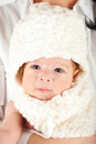 Beauty newborn baby boy with bunny cap in his mother arms Royalty Free Stock Photos