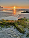 Beauty ocean coast sunrise the reflection of the sun on the sea surface at low tide Stock Photo