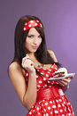 Beauty pin-up girl with the cake Royalty Free Stock Photography