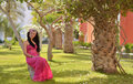 Beauty in pink dress dreaming in summer garden Royalty Free Stock Photo