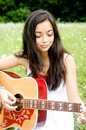 Beauty playing guitar Royalty Free Stock Images