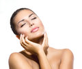Beauty portrait beautiful spa woman touching her face Stock Photography