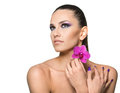 Beauty portrait of  beautiful woman with a flower Royalty Free Stock Photo