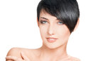 Beauty portrait of beautiful young woman with short hairstyle over on white Stock Photography