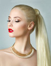 Beauty portrait of blonde woman with ponytail Royalty Free Stock Photo