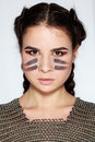 Beauty portrait of cheeky young woman in chain mail close up bright makeup light background Stock Photo