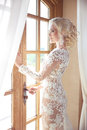 Beauty Portrait of elegant bride in wedding dress looking at window Royalty Free Stock Photo