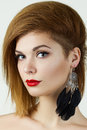 Beauty portrait of ginger girl with black earring Royalty Free Stock Image