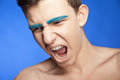 Screaming handsome male with creative make-up Royalty Free Stock Photo