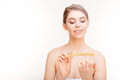 Beauty portrait of smiling young woman filing her nails Royalty Free Stock Photo