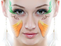 Beauty Portrait. On white background. Perfect Fresh Skin closeup with face paint. Royalty Free Stock Photo