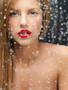 Beauty portrait of woman behind wet window Stock Images