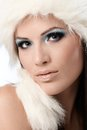 Beauty portrait of woman in fur cap and makeup young white professional Royalty Free Stock Image
