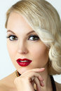 Beauty portrait of young blonde woman with retro style make up Stock Photography