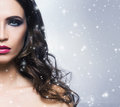 Beauty portrait of a young and gorgeous woman in snowflakes Royalty Free Stock Photo