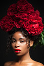 Beauty portrait of a young pretty girl with red flowers on her head. Royalty Free Stock Photo