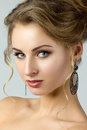 Beauty portrait of young woman with black earrings Royalty Free Stock Photo