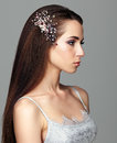 Beauty portrait of young woman. Brunette girl with brooch in lon Royalty Free Stock Photo
