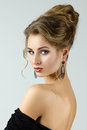 Beauty portrait of young woman with stylish hairdo looking straight to camera Royalty Free Stock Photo