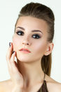 Beauty portrait of young woman touching her face Royalty Free Stock Images