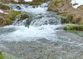 Beauty and power of winter water streams with cascades Royalty Free Stock Photo