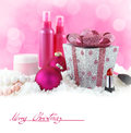 Beauty products with snow and pink background christmas presents Royalty Free Stock Image