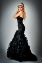 Beauty Queen in Ball Gown Dress. Stock Photo