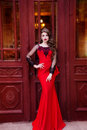 Beauty queen in a red dress with long hair and a tiara on her head Royalty Free Stock Photo