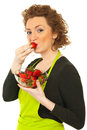 Beauty redhead woman eating strawberry Royalty Free Stock Photo