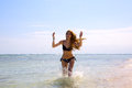 Beauty running beautiful young woman by tropical sea Stock Image