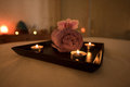 Beauty salon decoration in massage room, candles, towel and orch Royalty Free Stock Photo
