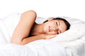Beauty sleep and dreaming woman happily sleeping in white bed isolated Stock Photos