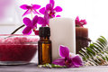 Beauty spa settings with oil salt and orchids Stock Photos