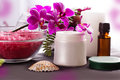 Beauty spa settings with orchids oil and cream Stock Photography