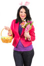 Beauty spring woman with bunny ears holding easter basket and flowers Royalty Free Stock Photo