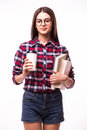 Beauty student girl and books drink tea or coffee from paper cup Royalty Free Stock Photo