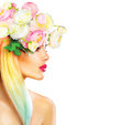 Beauty summer model girl with blooming flowers hairstyle Royalty Free Stock Photo