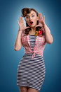 Beauty Surprised pinup girl on blue background Royalty Free Stock Photo
